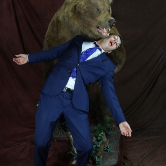 Aris Dreimanis and Bear having a friendly tumble.