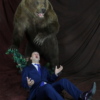 Aris Dreimanis and Bear having a friendly tumble or mauling in slow motion?