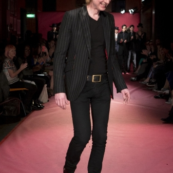 Sir Tom Baker finishing off his catwalk show at the 100 Club with a designers walk in his tonic patent Rochester boots!