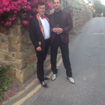 Jamie Poulton and Steve Lewis dressed for antics  at the Point to Point Summer Ball.
