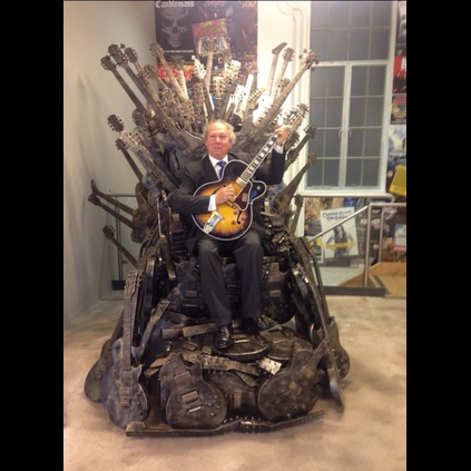 Alan Dublon sitting on a Gibson Game of Thrones Throne at the Gibson London HQ wearing his JWs!