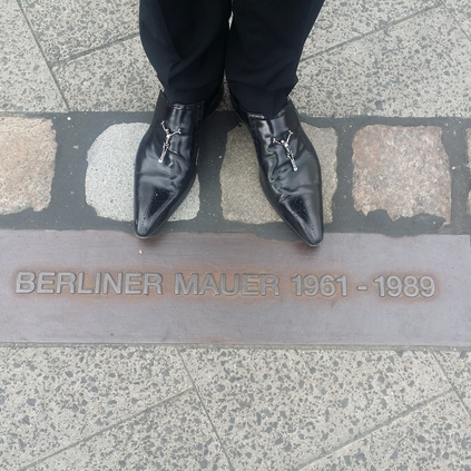 Rusty Egan at the Berlin Wall in his Ziggy Skull Horsleys!