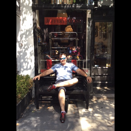 Mr Stuart Gale relaxing outside our New York store sporting the Lennon - Jet Set Driver Trainers in Black Calf.