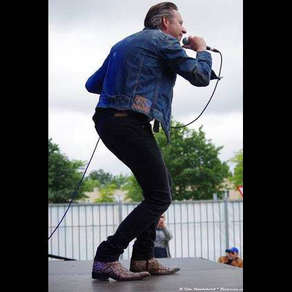 Marcel Duprix performing on stage with his band Mojo Man, in the Rochester Natural Snake boots!