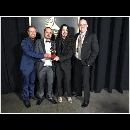 Ruben receiving his Latin Grammy in his Lynott boots