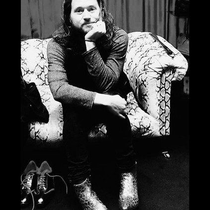 Reptilian Jay Buchanan of Rival Sons wearing Smaug Big Bangboots